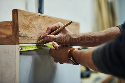 Buy stock photo Cropped shot of a carpenter working on a piece in his workshop