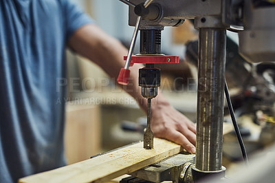 Buy stock photo Cropped shot of a carpenter using a drill press in his workshop