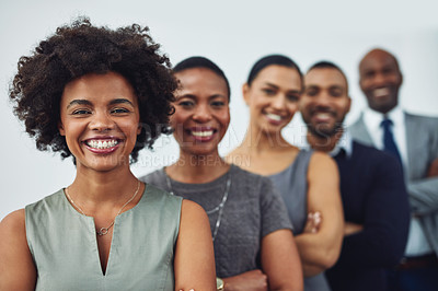 Buy stock photo Cropped portrait of a group of businesspeople standing with their arms folded in their corporate office