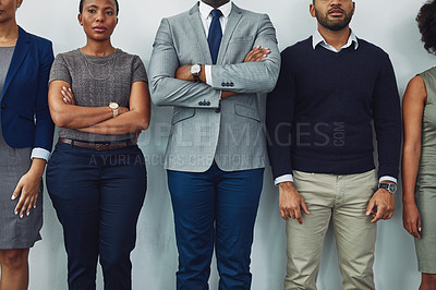 Buy stock photo Cropped shot of a group of businesspeople standing in line for their interview