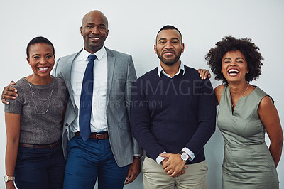 Buy stock photo Cropped portrait of a group of businesspeople standing in line in their corporate office