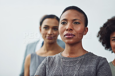 Buy stock photo Cropped shot of a group of businesspeople standing in their corporate office