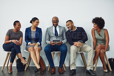 Buy stock photo Full length shot of a group of businesspeople waiting in line for their interview