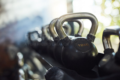 Buy stock photo Shot of weights in a modern gym