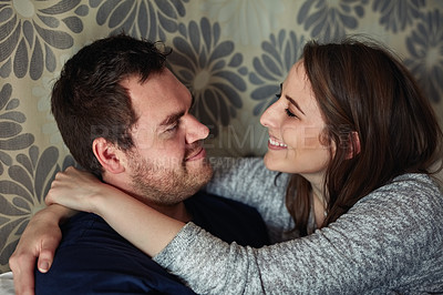 Buy stock photo Shot of a happy young couple sharing a romantic moment in the bedroom at home