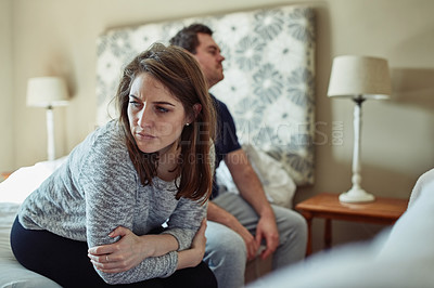 Buy stock photo Shot of a young couple having an argument in the bedroom at home