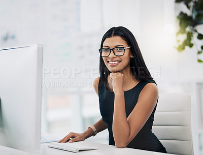 Buy stock photo Shot of an attractive young woman sitting in her office