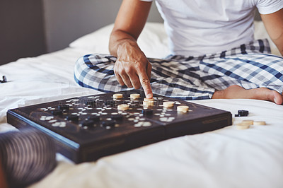 Buy stock photo Cropped shot of an unrecognizable father playing a board game with his daughter at home