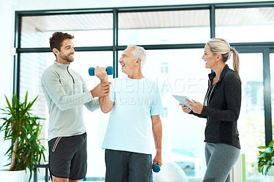 Buy stock photo Shot of physiotherapists working with a senior therapist