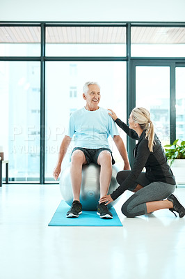 Buy stock photo Shot of a senior man working out in a rehabilitation center
