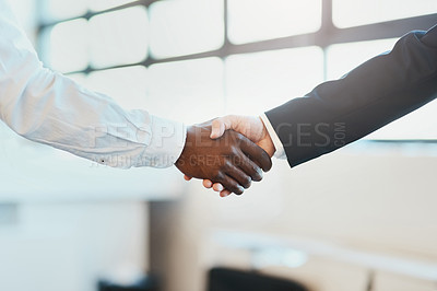 Buy stock photo Closeup of two unrecognizable businesspeople shaking hands in agreement inside of the office at work