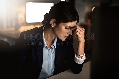 Buy stock photo Shot of a young businesswoman experiencing stress during a late night in a modern office