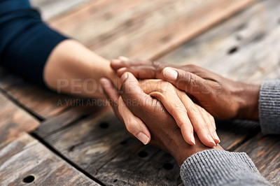 Buy stock photo High angle shot of an unrecognizable senior couple holding hands in comfort outside