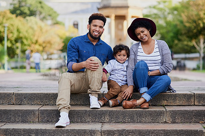 Buy stock photo Shot of a happy young family spending the day at the park