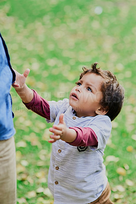 Buy stock photo Shot of a little boy reaching out to be picked up