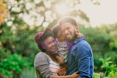 Buy stock photo Shot of a happy young family spending the day outdoors