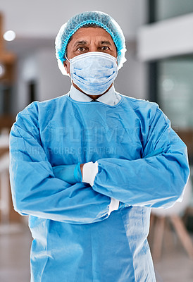 Buy stock photo Portrait of a surgeon standing in a hospital