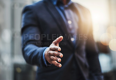 Buy stock photo Closeup shot of an unrecognizable businessman extending a handshake in the  city