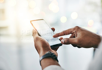 Buy stock photo Studio shot of an unrecognizable young man using his cellphone against a grey background