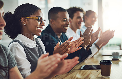 Buy stock photo Cropped shot of a group of young businesspeople applauding while sitting in the conference room during a seminar