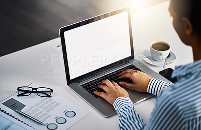 Buy stock photo Closeup shot of an unrecognizable businesswoman working on a laptop in an office