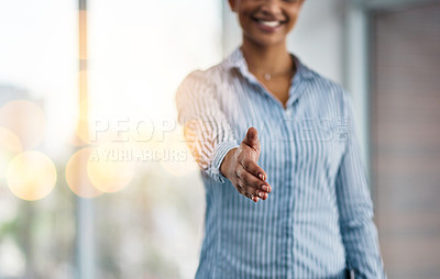 Buy stock photo Closeup shot of an unrecognizable businesswoman extending a handshake in an office