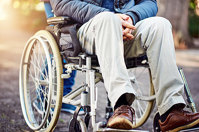 Buy stock photo Cropped shot of an unrecognizable senior wheelchair-bound man sitting in the park