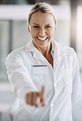 Buy stock photo Cropped portrait of an attractive mature female scientist writing down formulas on a glass wipe board while doing research in her lab