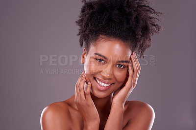 Buy stock photo Studio portrait of a beautiful young woman posing against a purple background