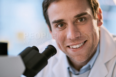 Buy stock photo Cropped portrait of a handsome young male scientist checking samples in his lab