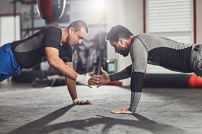 Buy stock photo Cropped shot of two professional fighters sparring in the gym