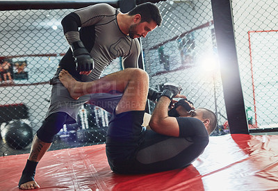 Buy stock photo Full length shot of two professional fighters sparring in the gym
