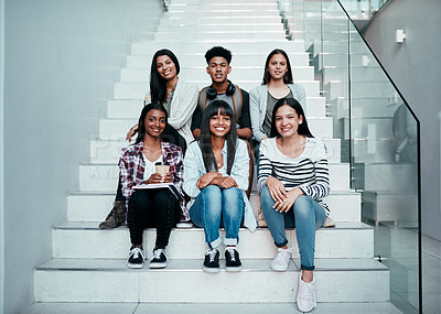 Buy stock photo Portrait of a group of university students sitting on a staircase at campus