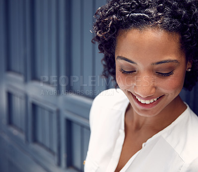 Buy stock photo Cropped shot of a young attractice businesswoman in a corridor at the office