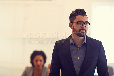 Buy stock photo Cropped shot of a young handsome businessman in the office
