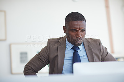 Buy stock photo Cropped shot of a young businessman working in the office