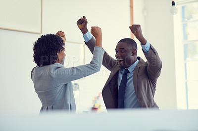 Buy stock photo Cropped shot of a young businessman and  businesswoman arms raised in celebration in the office