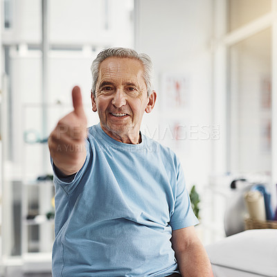 Buy stock photo Shot of a senior man showing thumbs up in a rehabilitation centre