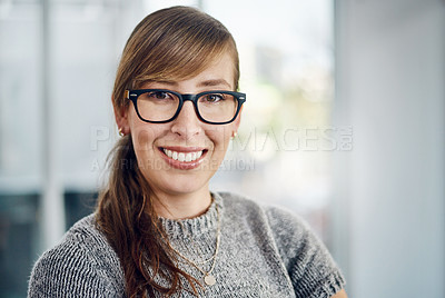 Buy stock photo Portrait of a cheerful young businesswoman standing inside the office with her arms folded at work during the day