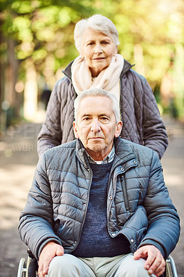 Buy stock photo Cropped portrait of a wheelchair-bound senior man spending the day with his wife in the park