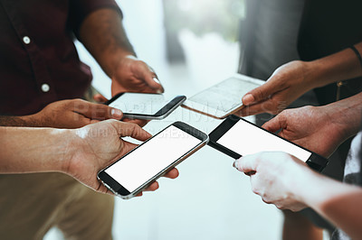 Buy stock photo Cropped shot of a group of businesspeople using their mobile phones together