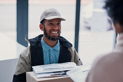 Buy stock photo Cropped shot of a young man making a delivery