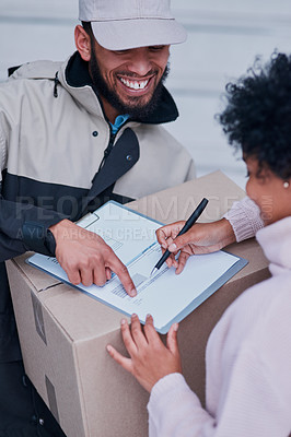 Buy stock photo Cropped shot of a young man making a delivery to a female customer