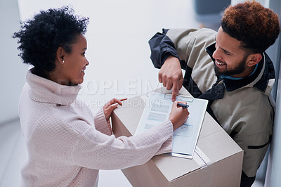Buy stock photo Shot of a young man making a delivery to a female customer