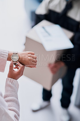 Buy stock photo Cropped shot of an unecognizable female customer checking the time waiting for a delivery