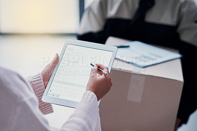 Buy stock photo Cropped shot of a delivery being made and a customer signing on a tablet inside