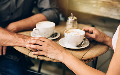 Buy stock photo Cropped shot of a couple having coffee together at a cafe
