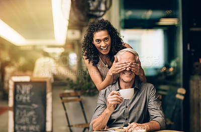 Buy stock photo Portrait of a mature woman covering her husband's eyes on a coffee date