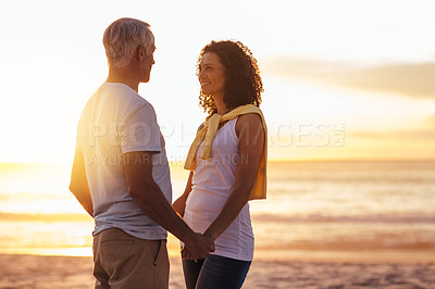 Buy stock photo Shot of a mature couple sharing a romantic moment at the beach