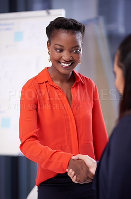 Buy stock photo Shot of a group of young businesswomen shaking hands in a modern office
